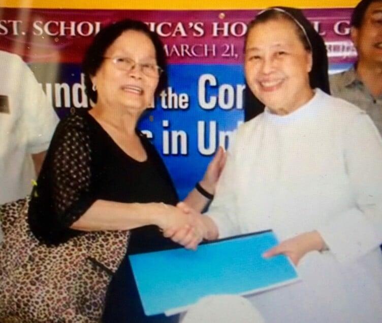 Mrs. Salazar presenting deed to Sr. Mary John Mananzan