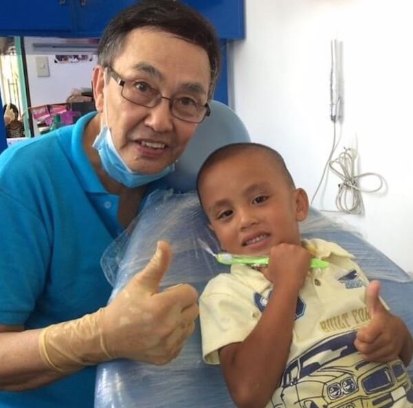 Dr. Ed de la Vega gives a thumbs up after examining a local village child.
